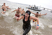 A young women runs out of the Cheseapeake Bay during the MSP Polar Bear Plunge in support of Special Olympics Maryland at Sandy Point State Park in Annapolis, MD on Saturday, January 29, 2011.