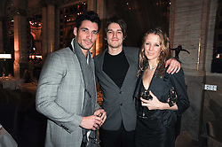 Left to right, DAVID GANDY and JESSE & TILLY WOOD at a party to celebrate the 135th anniversary of The Criterion restaurant, Piccadilly, London held on 2nd February 2010.