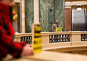 MADISON, WI – DECEMBER 19: Protestors hold signs urging the Wisconsin Presidential electors to change their votes in the Wisconsin State Capitol rotunda on Monday, December 19, 2016.