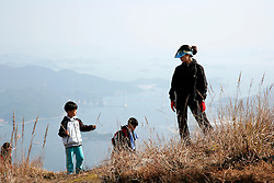 SOUTH KOREA MASAN 28OCT07 - Korean family on a day's hike enjoys the View from the hills around the port city of Masan, south Korea...jre/Photo by Jiri Rezac..© Jiri Rezac 2007..Contact: +44 (0) 7050 110 417.Mobile:  +44 (0) 7801 337 683.Office:  +44 (0) 20 8968 9635..Email:   jiri@jirirezac.com.Web:    www.jirirezac.com..© All images Jiri Rezac 2007 - All rights reserved.
