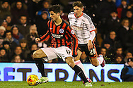 Emerson Hyndman of Fulham (right) chases Jo&atilde;o Carlos of Brighton and Hove Albion (left) during the Sky Bet Championship match at Craven Cottage, London<br /> Picture by David Horn/Focus Images Ltd +44 7545 970036<br /> 29/12/2014