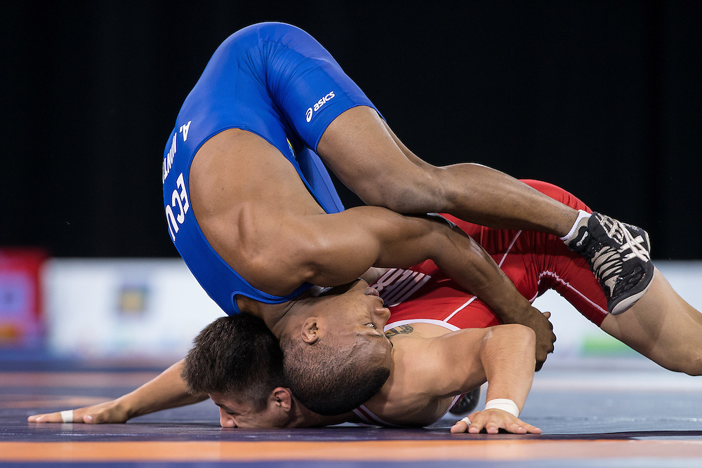 Andres Montano of Ecuador tries to leverage Ali Soto of Mexico during their gold medal bout in the 59kg weight class of the men's greco-roman wrestling at the 2015 Pan American Games in Toronto, Canada, July 15,  2015.  AFP PHOTO/GEOFF ROBINS