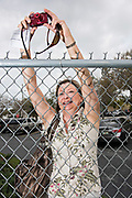 LARGO, FL - MARCH 12, 2016:  <br /> <br /> Karen Shulin, of Clearwater, Fla. takes a photo over the fence at the Pinellas County Rally with Marco Rubio, Saturday, March 12, 2016. &quot;It's a toss up between Trump and Rubio, but after listening to the last debate, I just think Rubio is super. He's a gentleman, very presidential.&quot;<br /> <br /> (Melissa Lyttle for The Wall Street Journal)