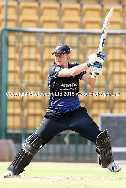 Sophine Devine of New Zealand plays a shot during the 3rd ODI match against India at Chinnaswamy Stadium in Bangalore.