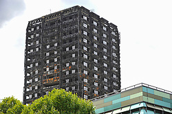 © Licensed to London News Pictures. 24/08/2017. London, UK. The burned out shell of Grenfell Tower stands near the route of the upcoming Notting Hill Carnival, where a million revellers are expected over the bank holiday weekend.  A quiet zone will be established during the Carnival with sound systems to be turned down in the vicinity of the tower.   Photo credit : Stephen Chung/LNP