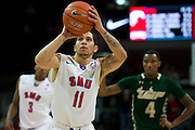 DALLAS, TX - JANUARY 15: Nic Moore #11 of the SMU Mustangs shoots a free-throw against the South Florida Bulls on January 15, 2014 at Moody Coliseum in Dallas, Texas.  (Photo by Cooper Neill/Getty Images) *** Local Caption *** Nic Moore