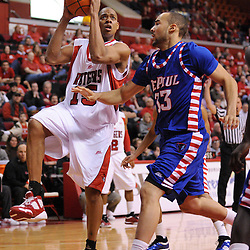 Jan 31, 2009; Piscataway, NJ, USA; Rutgers forward J.R. Inman (15) drives to the basket against DePaul center Krys Faber (33) during the second half of Rutgers' 75-56 victory over DePaul in NCAA college basketball at the Louis Brown Athletic Center