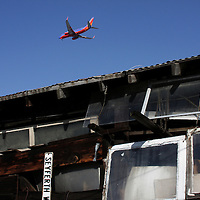 Plane flying over salvage yard in San Jose, Calfornia