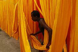 May 5, 2018 - Dhaka, Bangladesh - Dhaka, Bangladesh. A Bangladeshi worker dries clothes at a dyeing factory in Narayangonj, near Dhaka, Bangladesh on May 05, 2018. (Credit Image: © Rehman Asad/NurPhoto via ZUMA Press)