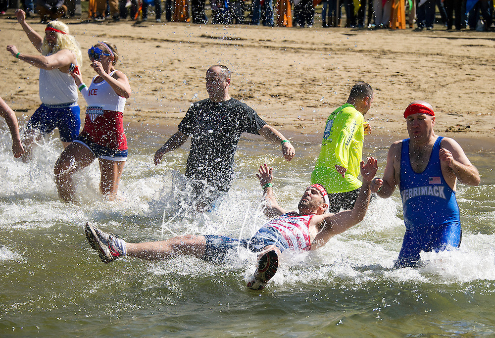 "Team ""Live, Freeze or Die"" from the Merrimack Police Dept made a splash during the 8th annual WInni Dip for Special Olympics at the Margate Beach on Saturday.   (Karen Bobotas/for the Laconia Daily Sun)"