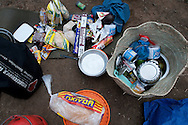 A menagerie of food items litter the ground at the Barranco Camp on the Machame Route up Kilimanjaro in Tanzania.