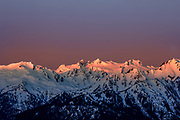 First light of the day hits the peaks of the Olympic Mountains in Olympic National Park Washington. Photo by Brandon Alms Photography