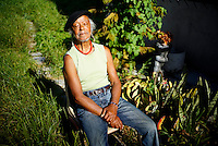James Matthews (85) is a South African poet that was persecuted and jailed during the apartheid regime. He lives in a small house in Silver Town, one of the townships of Cape Town, South Africa.  <br /> <br /> His mind is foggy, he says, and he doesn&rsquo;t write as often as he wishes. But a few minutes after telling me that, he offers to read me a poem he was writing that morning.: &ldquo;I'm sitting in the sun full of serenity and butterflies flutter around me&hellip;&rdquo;<br /> <br /> The grass in his front yard has not been cut in a long time and there are wild flowers and vines everywhere. A man rings the bell, he wants to cut the grass&hellip; &ldquo;Can you believe that? Doesn&rsquo;t he understand that not cutting the grass is a statement?&rdquo; <br /> <br /> When I ask him to pose for a portrait he tells me that he wants to sit on his &ldquo;throne&rdquo;, an old chair by the cement wall that separates his garden from his neighbor&rsquo;s that is completely covered with vines. He sits down and practically dissapears in the middle of the plants. Do you often sit here? I ask him. Of course not, only when I pose for a photographer like you, he says with a big grin.<br /> <br /> He walks to his chair, already in the sun, sits down and closes his eyes. A white butterfly flutters around him and quickly goes away before I can snap a photo.<br /> <br /> He is well known as a dissident poet, a poet that used words to face apartheid&rsquo;s injustice. Being a black poet is not what defines him anymore, he says. Now that South Africa has achieved legal equality, he is more interested in the human condition. He knows he won&rsquo;t live long, he is 85 already, and now he wants to write about what it means to grow old and face death. Politics is important, but he wants to write about serenity and love. He has enough love poems to publish a collection.<br /> <br /> He reads me a poem he wrote when he was in jail as a political prisoner:<br /> <br /> think of me, sometime,<br /> as you lay enfold<br /> in your lover&rsquo;s arms<br /> enchanted by the music<br /> of hearts beating in time<br /> while I make love to myself