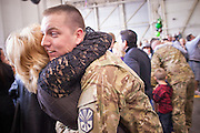 "15 JANUARY 2012 - PHOENIX, AZ:    Homecoming soldiers greet their family members at the The 161st Air Refueling Wing of the Arizona Air National Guard in Phoenix. About 100 soldiers of A (Alpha) Company of the 422nd Expeditionary Signal Battalion (referred to as ""Alpha 4-2-2"") of the Arizona Army National Guard returned to Arizona on Sunday, Jan. 15, following a nearly year-long deployment to Afghanistan. More than 10,000 Arizona Army and Air National Guard Soldiers and Airmen have been ordered to federal active duty in support of Operations Noble Eagle, Enduring Freedom, Iraqi Freedom, and New Dawn since September 2001. Approximately 200 Arizona National Guard Soldiers and Airmen are still serving on federal active duty overseas.  PHOTO BY JACK KURTZ"