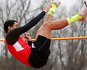 Savano Edwards of Hilton competes in the high jump at the His and Her track and field invitational at Penfield High School on Saturday, April 26, 2014.