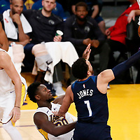 25 December 2017: Minnesota Timberwolves guard Tyus Jones (1) goes for the layup past Los Angeles Lakers forward Julius Randle (30) during the Minnesota Timberwolves 121-104 victory over the LA Lakers, at the Staples Center, Los Angeles, California, USA.