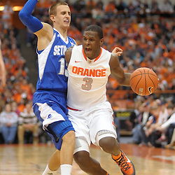 Syracuse Orange guard Dion Waiters (3) yells out while taking the foul by Seton Hall Pirates guard Haralds Karlis (13) in the second half at the Carrier Dome in Syracuse, NY. Top ranked Syracuse defeated Seton Hall 75-49 in front of a crowd of 25,081 in the Big East season opener.