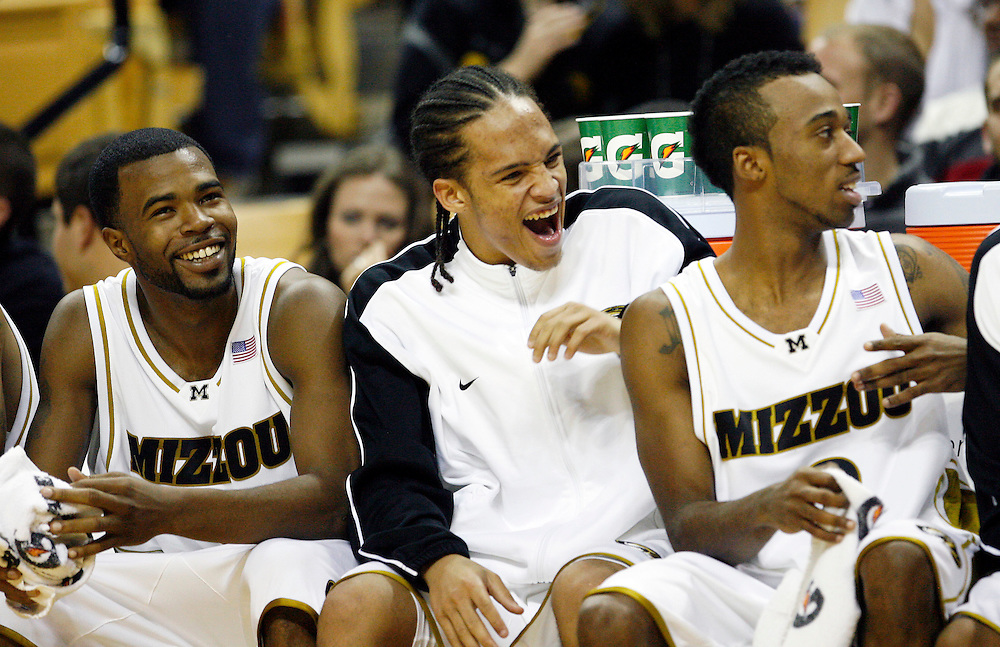 PATRICK T. FALLON/Missourian 310-920-2185.Missouri senior guard Zaire Taylor (cq), freshman guard Michael Dixon (cq) and Miguel Paul (cq) laugh on the bunch during the second half of the basketball game between the Missouri Tigers and Arkansas-Pine Bluff Lions at Mizzou Arena in Columbia, Mo. Saturday night, Dec. 19, 2009. Missouri defeated the Lions 88-70.