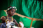 A young girl dances while sitting in a palanquin during the parade held on the occasion of the annual Oguaa Fetu Afahye Festival in Cape Coast, Ghana on Saturday September 6, 2008..