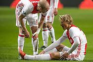 18-12-2016: Voetbal: Ajax v PSV: Amsterdam<br /> <br /> (L-R) Ajax speler Kasper Dolberg valt geblesseerd uit tijdens het Eredivisie duel tussen Ajax en PSV op 18 december in De Arena tijdens speelronde 17<br /> <br /> Eredivisie - Seizoen 2016 / 2017<br /> <br /> Foto: Gertjan Kooij