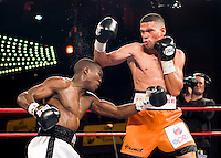 Manuel Lopez (right) defeats Rogers Mtagwa at Madison Square Garden to retain his WBO Super Bantamweight title.