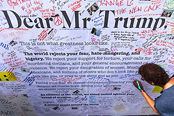 © Licensed to London News Pictures. 13/07/2018. London, UK. People leave messages for Donald Trump alongside an open letter from Avaaz as thousands of protesters march through central London against the President of the United States of America Donald Trump's visit to the United Kingdom. Photo credit: Rob Pinney/LNP