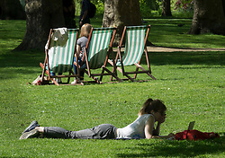 © Licensed to London News Pictures. 04/05/2018. London, UK. A visitor to St James's Park in central London enjoys the shade of a tree. High temperatures are expected to continue throughout the bank holiday weekend. Photo credit: Peter Macdiarmid/LNP