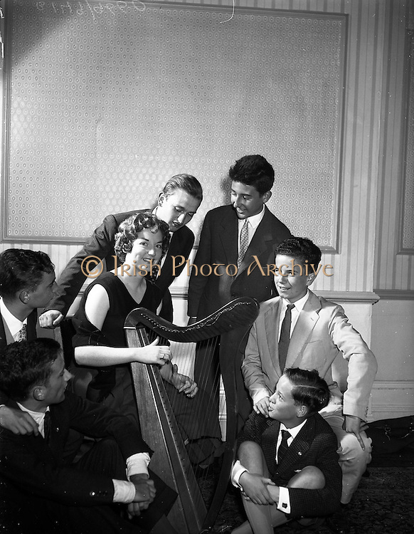 26/08/1959<br /> 08/26/1959<br /> 26 August 1959<br /> Spanish students at a performance of the Gael - Linn Cabaret at the Central Hotel, Dublin. No language barrier here as Kathleen Watkins sings to her own accompaniment on the Irish harp surrounded by some of the Spanish students. Although the boys from Madrid and Barcelona did not know a word of Irish they enjoyed Kathleen's singing.