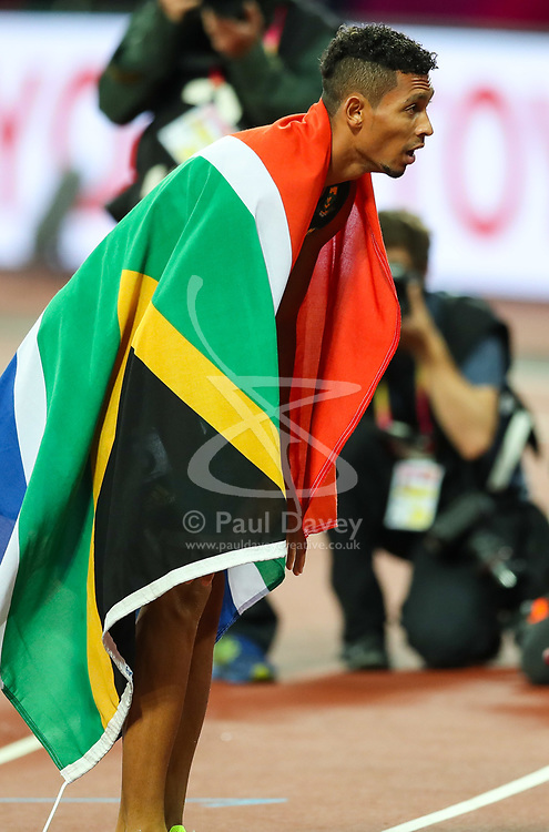 London, August 08 2017 . Wayde van Niekerk, South Africa, draped in his country's flag after winning the men's 400m final on day five of the IAAF London 2017 world Championships at the London Stadium. © Paul Davey.