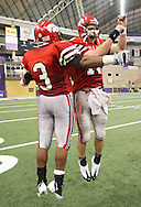 City High running back Ellis Jordan (3) and quarterback AJ Derby celebrate their win after their Class 4A semifinal game at the UNI Dome in Cedar Falls on Friday November 13, 2009.