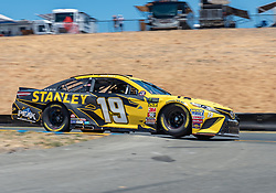 June 22, 2018 - Sonoma, CA, U.S. - SONOMA, CA - JUNE 22:  Daniel Suarez, driving the #(19) Toyota for Joe Gibbs Racing bounces over turn 8 on Friday, June 22, 2018 at the Toyota/Save Mart 350 Practice day at Sonoma Raceway, Sonoma, CA (Photo by Douglas Stringer/Icon Sportswire) (Credit Image: © Douglas Stringer/Icon SMI via ZUMA Press)