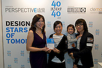 Designers Grace Kwok and Philip Lau receive their 40 Under 40 Perspective magazine award from Debbie Leung from Mooi Living (R).