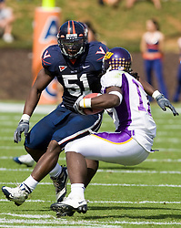 Virginia linebacker Clint Sintim (51) contains East Carolina wide receiver Dwayne Harris (17).  The Virginia Cavaliers defeated the East Carolina Pirates 35-20 in NCAA football at Scott Stadium on the Grounds of the University of Virginia in Charlottesville, VA on October 11, 2008.