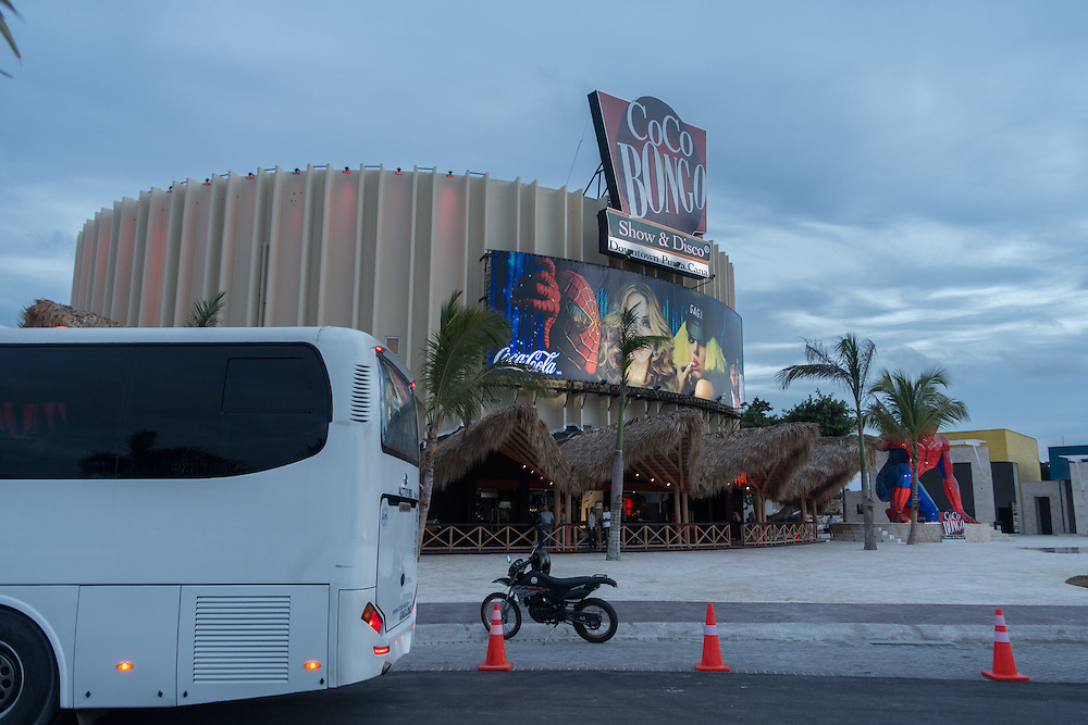 BAVARO, DOMINICAN REPUBLIC-DECEMBER 3, 2014: <br /> In a shopping center in B&aacute;varo a disco and entertainment establishment called Coco Bongo beckons tourists who arrive in buses daily to enjoy variety shows, music and dancing. Story on tourism to the Caribbean Island.  (Photo by Angel Valentin/Getty Images for Der Spiegel)