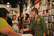 Paolo Nutini meeting his audience at Waterloo Records, Austin Texas, September 4, 2009. Paolo Giovanni Nutini (born 8 January 1987) is a singer/songwriter from Paisley Scotland.  Waterloo Records is an independent record store in Austin Texas.