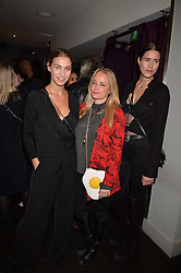 Left to right, Colette Gibson, Erica Bergsmeds and Katie Alexander-Thom at an exhibition of photographs by Erica Bergsmeds held at The Den, 100 Wardour Street, London England. 19 January 2017.