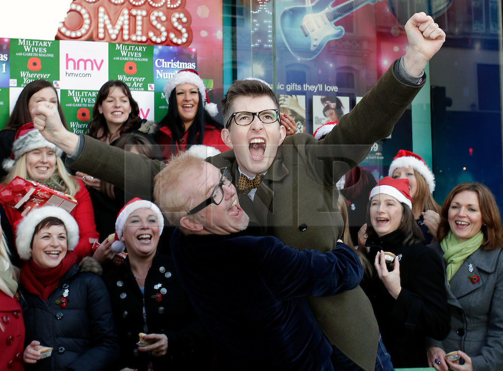 © Licensed to London News Pictures. 20/12/2011. London, United Kingdom .Chris Evans picks up Gareth Malone in front of the Military Wives Choir outside of HMV on Oxford Street to celebrate the success of the Military Wives single..Photo credit : Chris Winter/LNP