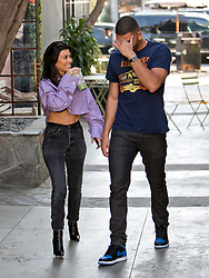 EXCLUSIVE: Kourtney Kardashian and her much younger Model boyfriend Younes Bendjima were and smiles as they picked up Fresh Juice on Melrose Place in West Hollywood, CA Kourtney and Younes sat together chatting for around 30 minutes before they happy couple got up laughing as they left the outdoor area at the juice shop. Yours walked Kourtney to her Range Rover an then he went his own way. 05 Feb 2018 Pictured: Kourtney Kardashian, Younes Bendjima. Photo credit: MEGA TheMegaAgency.com +1 888 505 6342