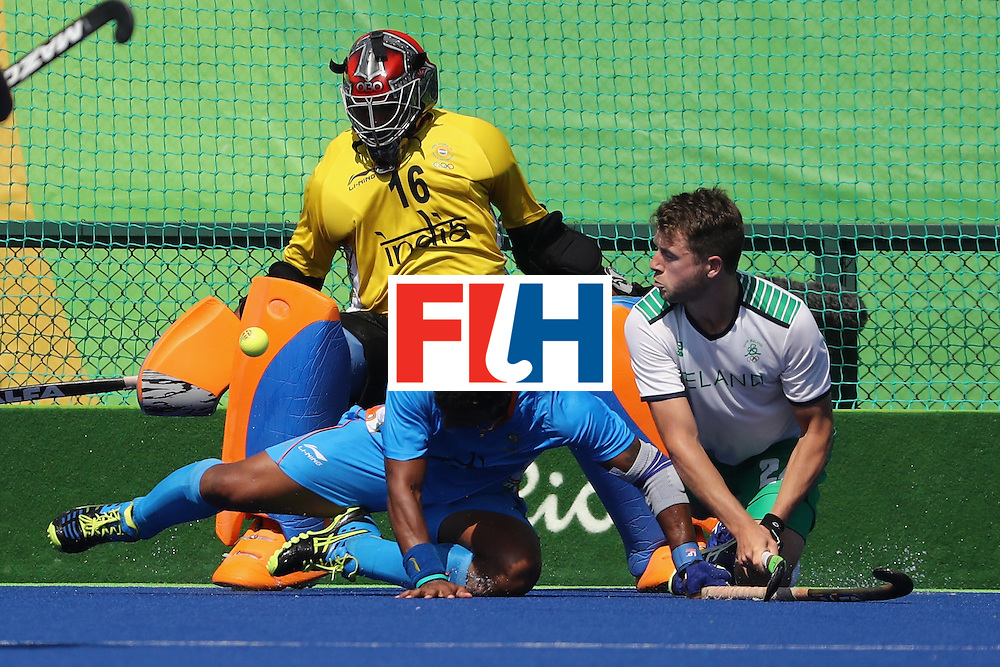 RIO DE JANEIRO, BRAZIL - AUGUST 06:  Sreejesh Parattu #16, and Raghunath Vokkaliga #12 of India defend against Kyle Good #24 of Ireland during a Pool B match between Ireland and India on Day 1 of the Rio 2016 Olympic Games at the Olympic Hockey Centre on August 6, 2016 in Rio de Janeiro, Brazil.  (Photo by Sean M. Haffey/Getty Images)