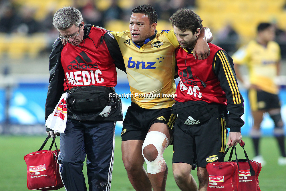 Hurricanes' Alapati Leiua leaves the field injured during the Round 17 Super Rugby match, between the Hurricanes & Crusaders. Westpac Stadium, Wellington. 28 June 2014. Photo.: Grant Down / www.photosport.co.nz
