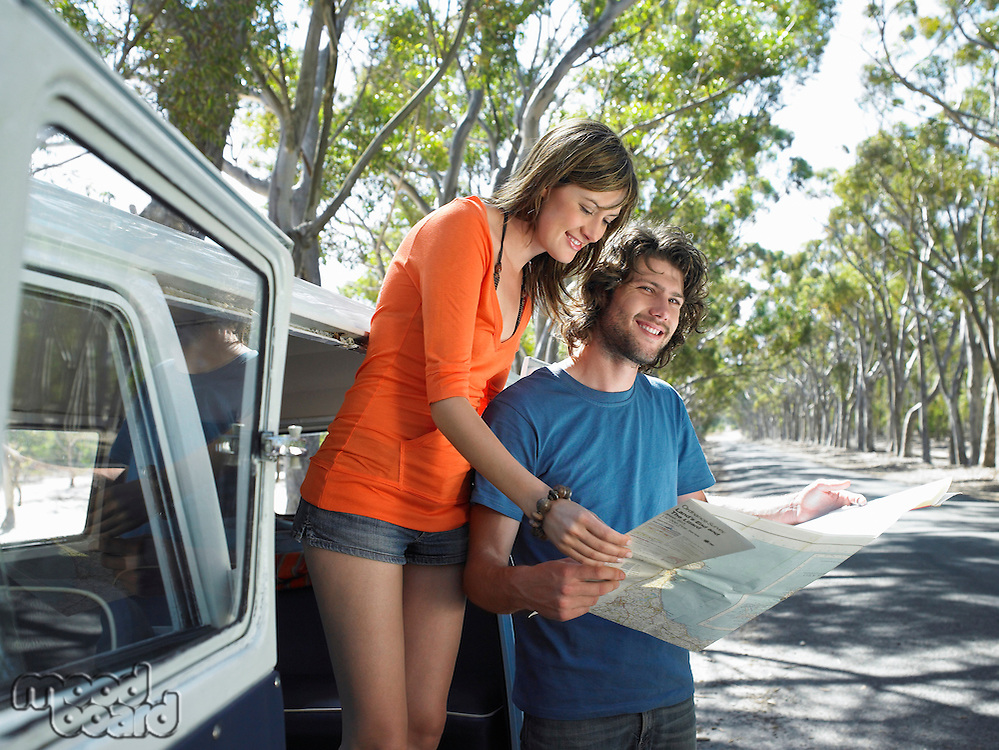 Young Couple Reading Map on Road Trip