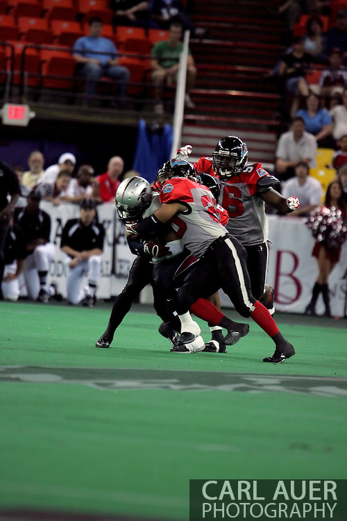 6-28-2007: Anchorage, AK - The Alaska Wilds Thomas Ford Jr.(3) battles for yards against the Centex Barracudas in the Alaska Wild 47 to 53 loss to the CenTex Barracudas at the Sullivan Arena...