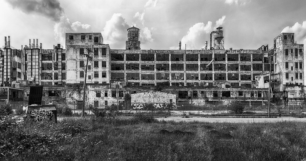 DETROIT, USA - JUNE 9, 2015: The Fisher Body Plant is now shut down and covered in graffiti but was used in automotive manufacturing from 1919 until 1984. The building was designed by Albert Kahn and built in 1919.