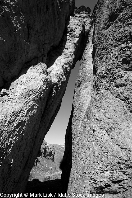 A thin arch cut in the Rhyolite cliff along Arch Canyon/Cougar Creek, deep in the Owyhee Canyonlands of Idaho.