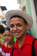 A young man dressed in traditional Puerto Rican costume at the Festival of San Sebastian in San Juan, Puerto Rico.