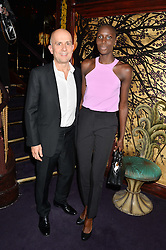 MARC QUINN and JENNY BASTET at a party to celebrate the launch of the Dee Ocleppo 2015 Pre Fall Collection benefiting the Walkabout Foundation held at Loulou's, 5 Hertford Street, London on 16th June 2015.