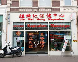 Typical Chinese shop offering massage services in Chinatown in The Hague Netherlands