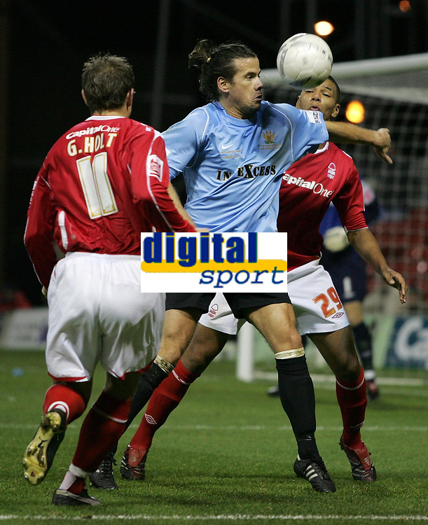 Photo: Paul Thomas.<br /> Nottingham Forest v Salisbury. The FA Cup. 12/12/2006.<br /> <br /> Salisbury player Paul Sales (Blue) fights off Julian Bennett (R) and Grant Holt (L).
