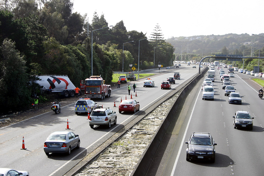 Traffic on the Southern Motorway was delayed after a tree fell in front of a cement trucking causing it crash off the road, Auckland, New Zealand, Saturday, Speptember 28, 2013. Credit:SNPA / Grahame Clark