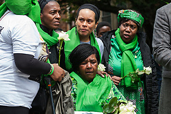 London, UK. 14 June, 2019. Family members prepare to release doves of peace following a memorial service at St Helen's Church to mark the second anniversary of the Grenfell Tower fire on 14th June 2017 in which 72 people died and over 70 were injured.